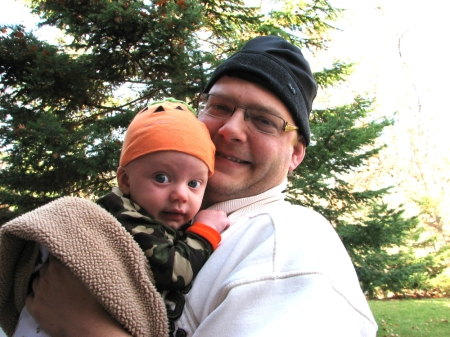 It's Uncle Dan's job to hold baby Lincoln.