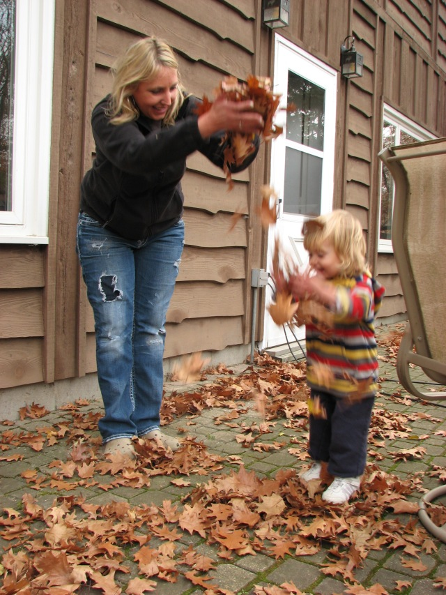 It's Ella's job to play with the leaves.